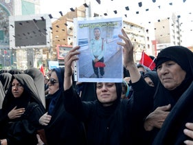 Mourners attend the funeral held for those killed in a military parade shooting in the southwest Iranian city of Ahvaz, September, 2018.
