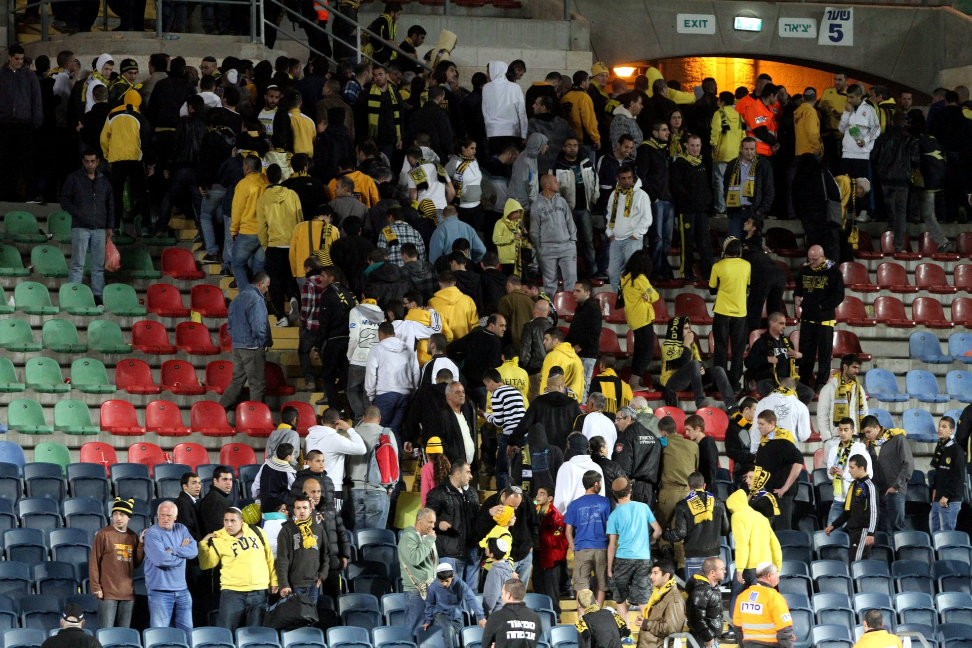 Beitar Jerusalem soccer fans leaving Teddy Stadium after one of the team's Chechen Muslim players, Zaur Sadayev, scores a goal at a game in March, 2013.