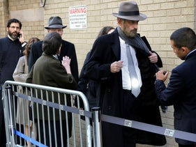Security personnel searching people's bags and clothes as they arrive for an interfaith service at Park East Synagogue in New York, October 31, 2018.