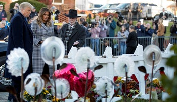 President Donald Trump, First lady Melania Trump and Tree of Life Rabbi Jeffrey Myers at a memorial for those killed at the Tree of Life Synagogue in Pittsburgh, October 30, 2018.