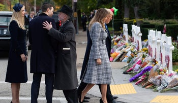 U.S. President Donald Trump and First Lady Melania Trump walk past a memorial, as Jared Kushner and Ivanka Trump speak with Rabbi Jeffrey Myers at the Tree of Life Synagogue in Pittsburgh, Pennsylvania, October 30, 2018.