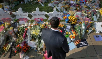 A man prays at a memorial outside the Tree of Life synagogue in Pittsburgh, Pennsylvania, October 31, 2018.