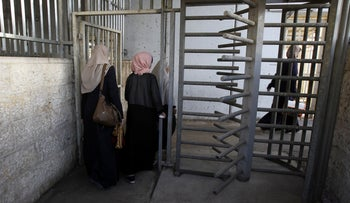 Two Palestinian women pass the checkpoint in Bethlehem.