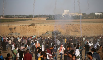Tear gas canisters are fired by Israeli troops towards Palestinians in the southern Gaza Strip November 2, 2018