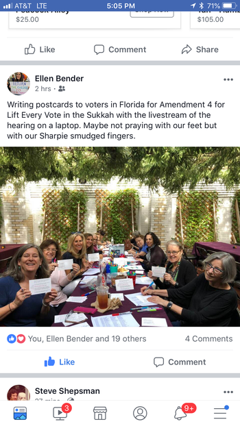 Jewish women gather in a sukkah to write postcards to send to voters, October 2018.
