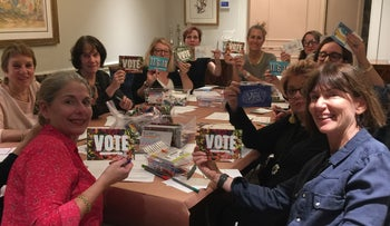Women gather in Susan Wagner's New York apartment to write postcards to voters in states where Democrats might flip Republican seats in Congress, October 2018.