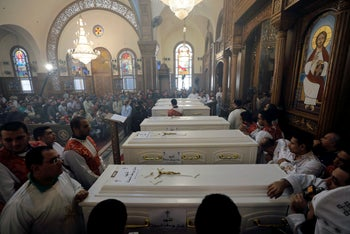 Mourners gather at Prince Tadros Church for the funeral of Coptic Christians who were killed in an attack, in Minya, Egypt November 3, 2018.
