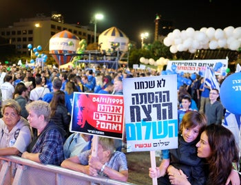 Activists gathering at Tel Aviv's Rabin Square ahead of the memorial for the late prime minister on October 3, 2018.