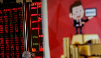 A man monitors stock prices at a brokerage house in Beijing, June 25, 2018.