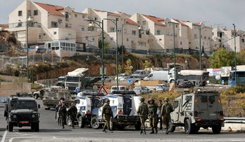 Israeli troops gather at the scene of an attempted stabbing attack near the Jewish settlement of Kiryat Arba in Hebron, in the occupied West Bank November 5, 2018.