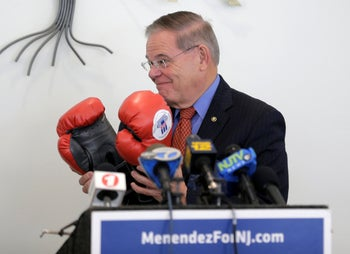 Democratic Sen. Bob Menendez receiving a gift of boxing gloves before speaking to a group of mostly seniors in Bloomfield, New Jersey, October 30, 2018.