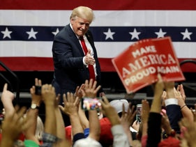President Donald Trump acknowledges the crowd as he leaves a rally Sunday in Chattanooga, Tenn.
