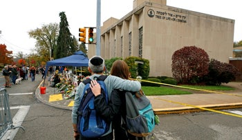 FILE PHOTO: People pay their respects at a makeshift memorial for the 11 people killed at the Tree of Life Synagogue, Pittsburgh, November 1, 2018