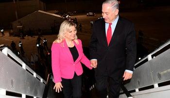 Prime Minister Benjamin Netanyahu and his wife Sara boarding a plane at Ben-Gurion International Airport in advance of a trip to Germany, February 17, 2018.