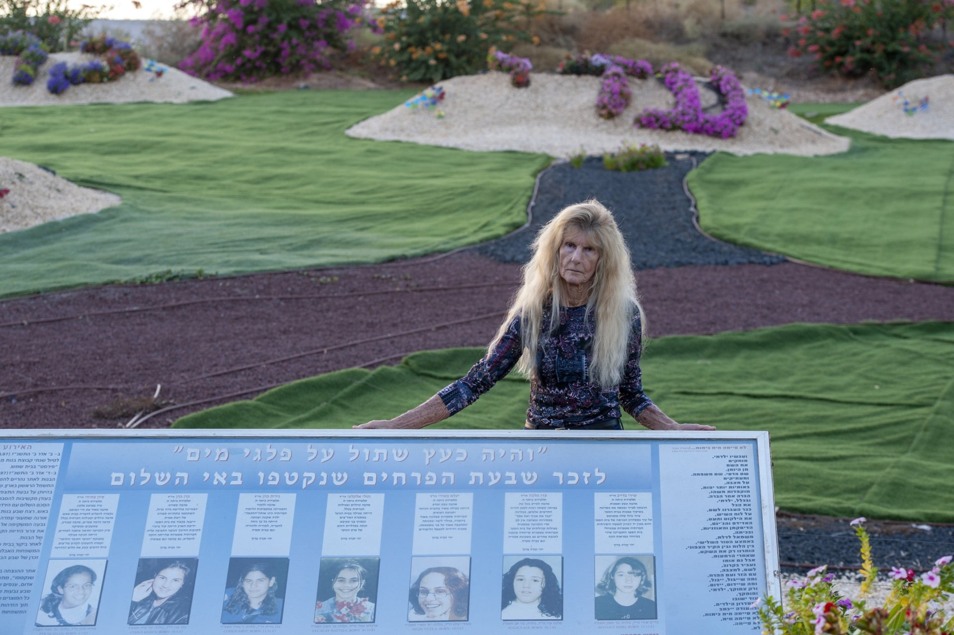 Orna Shimoni next to the memorial she maintains for the seven Israeli schoolgirls murdered by a Jordanian soldier in a March 1997 terror attack.