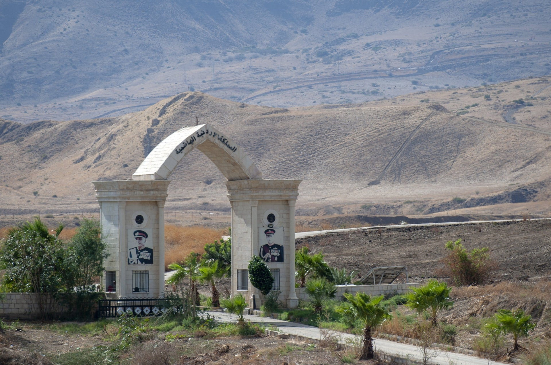 The gate built on the Island of Peace by the Jordanians a few years ago, including portraits of King Abdullah and the late King Hussein.