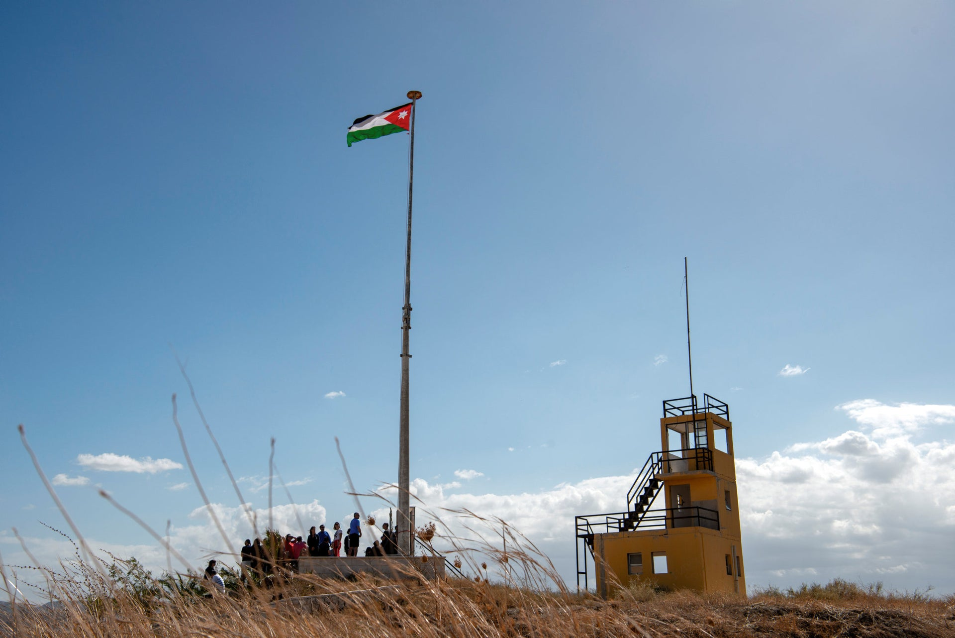 The Israeli tourists visiting a Jordanian outpost with the new recently installed flagpole in Naharayim.
