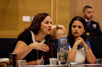 FILE Photo: Deputy Attorney General Dina Zilber and Ayelet Shaked in the Knesset, 2014.
