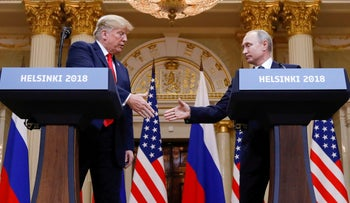 FILE PHOTO: U.S. President Donald Trump and Russia's President Vladimir Putin shake hands during a joint news conference after their meeting in Helsinki, Finland, July 16, 2018.