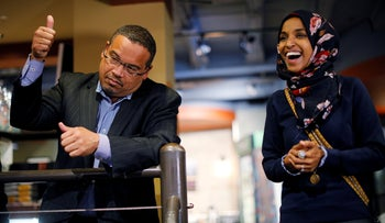 U.S. Democratic congressional candidate Ilhan Omar and Democratic candidate for state Attorney General Keith Ellison (L) speak to volunteers, October 26, 2018.