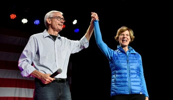 Democratic gubernatorial candidate Tony Evers (L) and U.S. Senator Tammy Baldwin (D-WI) react to supporters at an election eve rally in Madison, Wisconsin, U.S. November 5, 2018.