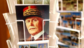 A postcard featuring French Marshal Philippe Petain is seen for sale at 40 cents at the souvenir shop of the Ossuary of Douaumont near Verdun, northeastern France, March 30, 2014.