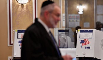 A member of the Jewish community casts his ballot in the midterm election at the East Midwood Jewish Center polling station, Brooklyn, New York City, November 6, 2018.