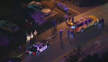 In this image made from aerial video, police vehicles line a road in the vicinity of a shooting in Thousand Oaks, California, early Thursday, Nov. 8, 2018. Authorities say there were multiple injuries _ including one officer _ after a man opened fire in Southern California bar late Wednesday.