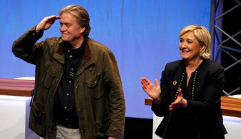 Former White House Chief Strategist Steve Bannon with French nationalist Marine Le Pen in Lille, France, March 10, 2018.