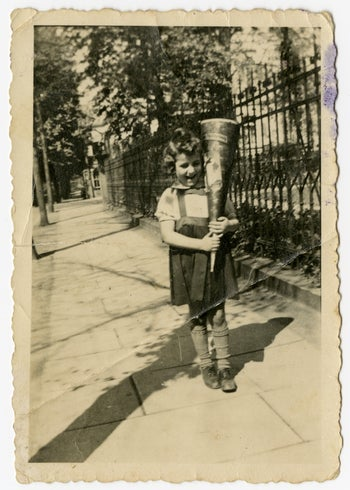 Susan Warsinger as a child. Recalls looking out of the window and seeing the town rabbi outside, having his beard shaved off by Nazi storm troopers.