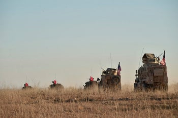 Turkish and U.S. troops conduct joint patrols around the Syrian town of Manbij, as part of an agreement that aimed to ease tensions between the two NATO allies. Nov. 1, 2018