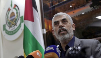 Hamas chief in Gaza Yahya Sinwar speaks to foreign correspondents, in his office in Gaza City, May 10, 2018.
