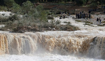 Civil defense members look for missing persons after rain storms unleashed flash floods, in Madaba city, near Amman, Jordan, November 10, 2018.