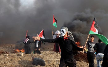 Protesters near the fence of Gaza Strip border with Israel during a protest east of Gaza City, November 9, 2018.