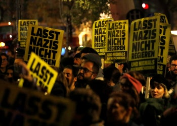 """Protesters carry posters reading """"Don't let Nazis rule"""" during a rally against Minister Herbert Kickl of the Freedom Party in Vienna, November 7, 2018."""