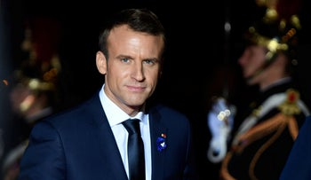 French President Emmanuel Macron arrives at the Musee d'Orsay in Paris on November 10, 2018 to attend a state dinner as part of ceremonies marking the 100th anniversary of the November armistice ending WWI