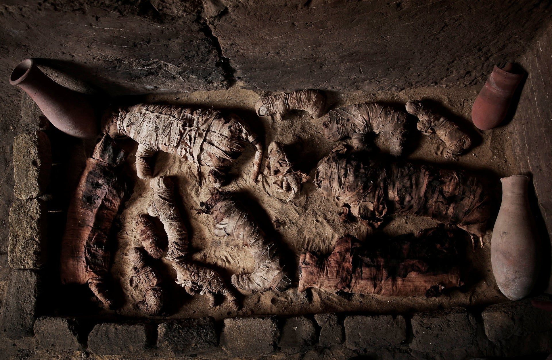 Mummified cats inside a tomb, at an ancient necropolis near Egypt's famed pyramids in Saqqara, Giza, Egypt, Saturday, Nov. 10, 2018. A top Egyptian antiquities official says local archaeologists have discovered seven Pharaonic Age tombs near the capital Cairo containing dozens of cat mummies along with wooden statues depicting other animals.