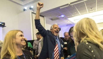 A campaign volunteer for Democratic candidate Harley Rouda cheering the election returns during an Election Day party in California, November 6, 2018. Rouda's victory over longtime Sen. Dana Rohrabacher was confirmed on Saturday.