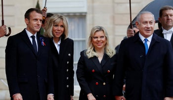 French President Emmanuel Macron and his wife Brigitte Macron welcome Israel Prime Minister Benjamin Netanyahu and his wife Sara, in Paris, France, November 11, 2018.