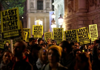 "Protesters carry posters reading ""Don't let Nazis rule"" during a demonstration against Austria's Interior Minister Herbert Kickl of the far right Freedom Party in Vienna, Austria. November 7, 2018"