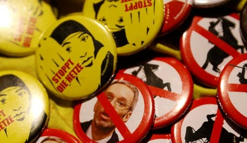 Badges on sale during a demonstration against Austria's Interior Minister Herbert Kickl of the Freedom Party (FPOe) in Vienna, Austria, November 7, 2018.