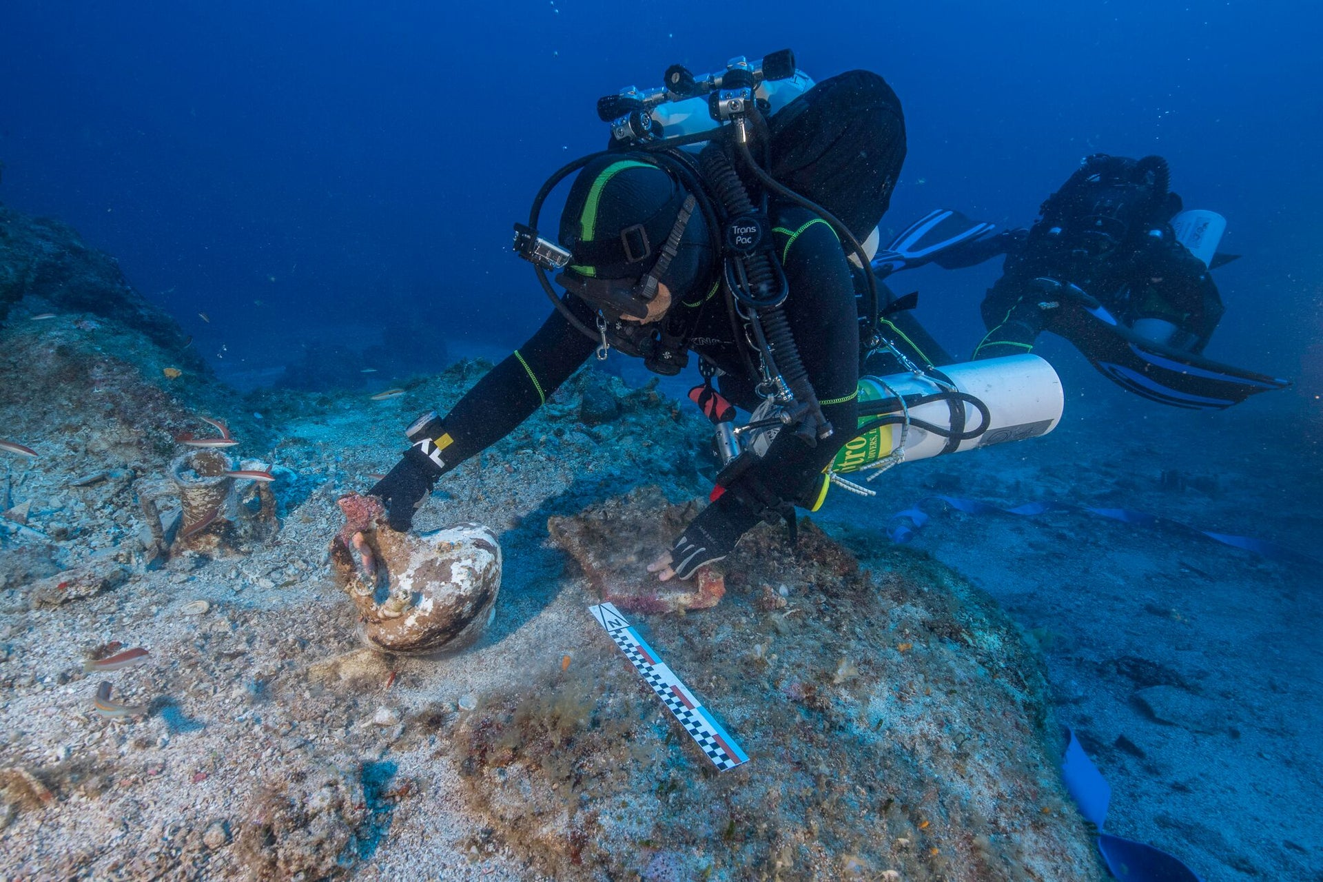Diver lifting amphora that possibly contained wine or perfume. The transport amphora's originates from Ephesus, Pergamum and the islands of Rhodes and Kos