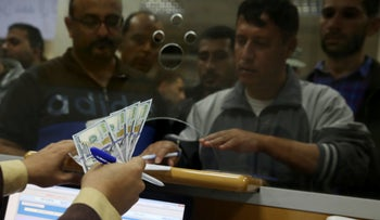 A Palestinian Hamas government employee waiting to receives 60 percent of their salary after $15 million arrived from Qatar, Gaza City, November 9, 2018.