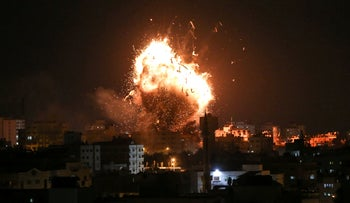 A ball of fire is seen above the building housing the Hamas-run Al-Aqsa TV during an Israeli airstrike in Gaza City, November 12, 2018.