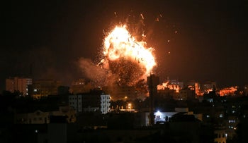 A ball of fire above the building housing the Hamas-run television station al-Aqsa TV in Gaza City during an Israeli air strike.
