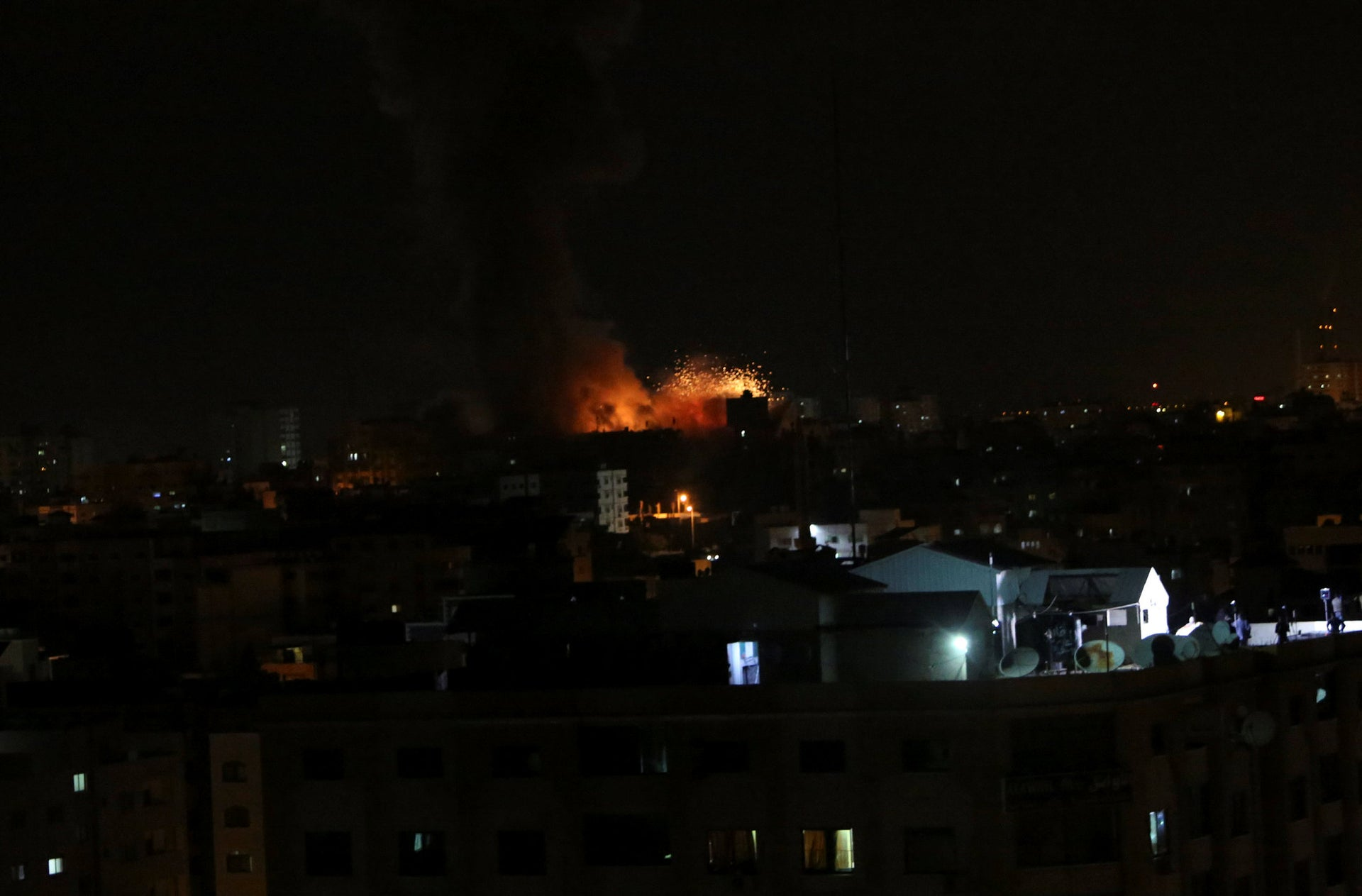 An explosion caused by Israeli airstrikes on the building of Hamas' Al-Aqsa TV station in Gaza City, Monday, Nov. 12, 2018.