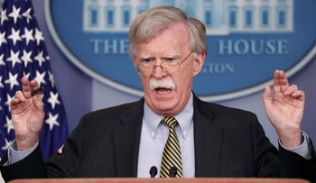 U.S. National Security Adviser John Bolton answers a question from a reporter during a news conference in the White House briefing room in Washington, October 3, 2018.