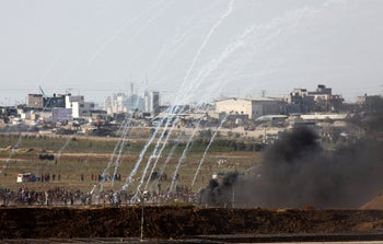 Burning tires (the thick black smoke) and launching incendiary balloons and kites from the Gazan border with Israel