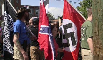 Demonstrators carry confederate and Nazi flags during the Unite the Right rally in Charlottesville, Virginia, August 12, 2017.