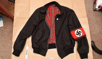 A jacket bearing a Swastika armband found during police searches of Adam Thomas and Claudia Patatas' home.